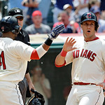 Cleveland Indians' Yan Gomes, right, celebrates with Carlos Santana (41) after both scored on a single by Mike Aviles in the fourth inning of the MLB American League baseball game against th …