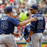 Tampa Bay Rays starting pitcher Chris Archer (22) gets a visit from pitching coach Jim Hickey (48) during a baseball game against the Cleveland Indians Saturday, June 1, 2013, in Cleveland.  …
