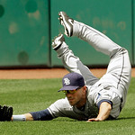 Tampa Bay Rays left fielder Sam Fuld makes a diving catch on a line drive by Cleveland Indians' Drew Stubbs to end the fourth inning of the MLB American League baseball game Sunday, June 2,  …
