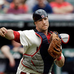Cleveland Indians catcher Yan Gomes throws out Tampa Bay Rays' Kelly Johnson on a ground ball in front of the plate in the third inning of a baseball game Sunday, June 2, 2013, in Cleveland. …