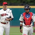 Cleveland Indians starting pitcher Ubaldo Jimenez, left, walks in from the bullpen with catcher Carlos Santana before a baseball game against the Tampa Bay Rays Saturday, June 1, 2013, in Cl …