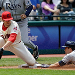 Tampa Bay Rays' Sam Fuld, right, slides into third to beat the tag from Cleveland Indians third baseman Mark Reynolds on a triple in the fourth inning of the MLB American League baseball gam …