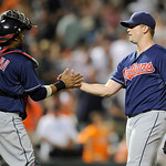 Cleveland Indians relief pitcher Vinnie Pestano, right, celebrates 5-2 win over the Baltimore Orioles with catcher Carlos Santana, left, in a baseball game, Monday, June 24, 2013, in Baltimo …