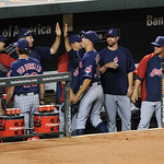 Cleveland Indians starting pitcher Ubaldo Jimenez, center, is greeted in the dugout after he came out of the baseball game against the Baltimore Orioles during the sixth inning, Monday, June …