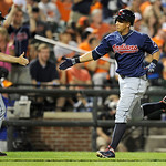 Cleveland Indians' Michael Brantley, right, rounds the bases after he hit a two-run home run as he is greeted by third base coach Brad Mills, left, during the eighth inning of a baseball gam …