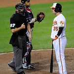 Baltimore Orioles' Danny Valencia (35) chats with home plate umpire Scott Barry (87) after he struck out during the sixth inning of a baseball game as Cleveland Indians catcher Carlos Santan …