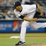 New York Yankees relief pitcher Mariano Rivera (42) delivers in the ninth inning of a baseball game at Yankee Stadium in New York, Monday, June 3, 2013.  (AP Photo/Kathy Willens)
