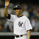 New York Yankees relief pitcher Mariano Rivera (42) waves to the crowd after closing out the Yankees 7-4 victory over the Cleveland Indians in a baseball game at Yankee Stadium in New York, …