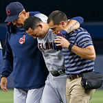 Cleveland Indians' Asdrubal Cabrera is helped by Indians manager Terry Francona, left, and a trainer as he leaves the field in the fifth inning after Cabrera strained his right quadriceps in …