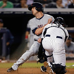 New York Yankees catcher Austin Romine (53) tags out Cleveland Indians' Drew Stubbs at the plate on a fly ball hit by Mike Aviles in a baseball game at Yankee Stadium in New York, Monday, Ju …
