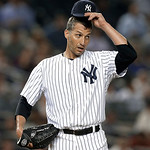 New York Yankees starting pitcher Andy Pettitte reacts in the fifth inning after a two-run ground-rule double by Cleveland Indians' Carlos Santana (41) in a baseball game at Yankee Stadium i …