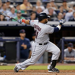 Cleveland Indians' Carlos Santana follows through on a fifth-inning ground-rule double off New York Yankees starting pitcher Andy Pettitte in a baseball game at Yankee Stadium in New York, M …