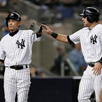 New York Yankees' Ichiro Suzuki and Austin Romine celebrate after they scored on Brett Gardner's sixth-inning single against the Cleveland Indians in a baseball game at Yankee Stadium in New …