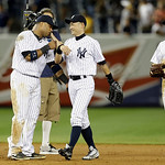 New York Yankees second baseman Robinson Cano, left, celebrates with New York Yankees right fielder Ichiro Suzuki (31) as New York Yankees center fielder Brett Gardner, right, looks on after …