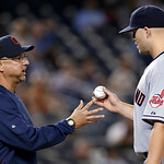 Cleveland Indians manager Terry Francona, left, takes the ball from starting pitcher Justin Masterson after Masterson allowed a seventh-inning solo home run to New York Yankees' Travis Hafne …