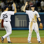 New York Yankees first baseman Mark Teixeira celebrates with New York Yankees third baseman Reid Brignac after the Yankees 7-4 victory over the Cleveland Indians in a baseball game at Yankee …