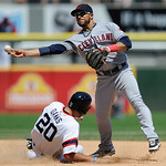 Cleveland Indians second baseman Mike Aviles right, throws to first base after forcing out Chicago White Sox's Jordan Danks left, at second base during the sixth inning of a baseball game in …