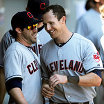 Cleveland Indians' Drew Stubbs, right, celebrates with teammate Jason Kipnis in the dugout after scoring on a Ryan Raburn double during the sixth inning of a baseball game against the Chicag …