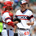 Chicago White Sox starting pitcher Chris Sale (49) talks with catcher Tyler Flowers after giving up two runs during the fourth inning of a baseball game against the Cleveland Indians in Chic …