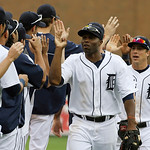 Detroit Tigers right fielder Torii Hunter, center, leads teammates at the end of a baseball game against the Cleveland Indians in Detroit, Sunday, June 9, 2013. Detroit defeated the Indians …