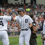 Detroit Tigers' Miguel Cabrera and Prince Fielder, right, congratulate Don Kelly, center, after his three-run home run during the sixth inning of a baseball game against the Cleveland Indian …