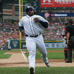 Detroit Tigers' Prince Fielder scores from third on a sacrifice fly by teammate Alex Avila during the second inning of a baseball game against the Cleveland Indians in Detroit, Sunday, June  …