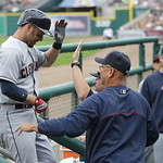 Cleveland Indians' Ryan Raburn arrives at the dugout after his solo home run during the fifth inning of a baseball game against the Detroit Tigers in Detroit, Sunday, June 9, 2013. (AP Photo …