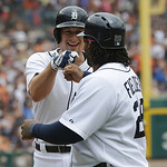 Detroit Tigers center fielder Don Kelly, left, is congratulated by teammate Prince Fielder after his three-run home run in the sixth inning off Cleveland Indians starting pitcher Justin Mast …