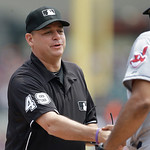 Umpire Andy Fletcher shakes hands with Cleveland Indians bench coach Sandy Alomar before the first inning of a baseball game against the Detroit Tigers in Detroit, Sunday, June 9, 2013. (AP …