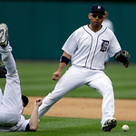 Detroit Tigers relief pitcher Drew Smyly, left, flips after making an attempt to catch a bunt pop by Cleveland Indians' Michael Bourn to second baseman Omar Infante during the eighth inning …