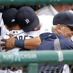 Detroit Tigers starting pitcher Jose Alvarez, back to camera left, is hugged by Avisail Garcia in the dugout after his major league debut during the sixth inning of a baseball game against t …