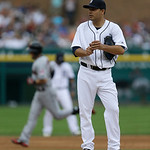 Detroit Tigers starting pitcher Jose Alvarez, foreground, stands on the mound as Cleveland Indians' Ryan Raburn rounds the bases after a solo home run during the fifth inning of a baseball g …