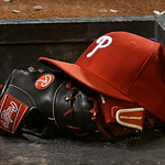A Philadelphia Phillies hat and glove rest on a step leading into the dugout in a baseball game between the Phillies and the Cleveland Indians, Wednesday, May 1, 2013, in Cleveland. (AP Phot …