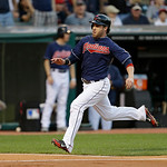 Cleveland Indians' Jason Kipnis, right, slides safely into home plate in the third inning of a baseball game against the Philadelphia Phillies, Wednesday, May 1, 2013, in Cleveland. Kipnis s …