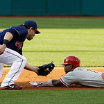 Cleveland Indians' Jason Kipnis, left, tags out Philadelphia Phillies' Jimmy Rollins at second base in the first inning of a baseball game on Wednesday, May 1, 2013, in Cleveland. Rollinswas …