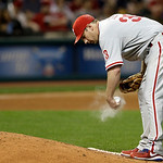 Philadelphia Phillies starting pitcher Cliff Lee works the rosin bag in the sixth inning of a baseball game against the Cleveland Indians, Wednesday, May 1, 2013, in Cleveland. (AP Photo/Ton …