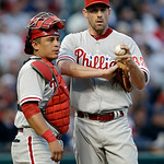 Philadelphia Phillies catcher Carlos Ruiz, left, talks with starting pitcher Cliff Lee in the third inning of a baseball game against the Cleveland Indians, Wednesday, May 1, 2013, in Clevel …