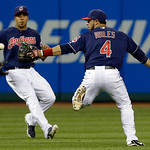 Cleveland Indians' Mike Aviles, right, and Michael Brantley run after a ball hit by Philadelphia Phillies' Domonic Brown in the sixth inning of a baseball game on Wednesday, May 1, 2013, in  …
