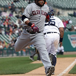 Cleveland Indians' Carlos Santana scores the go-ahead run on a Mark Reynolds single to left field during the tenth inning of a baseball game against the Detroit Tigers in Detroit, Sunday, Ma …