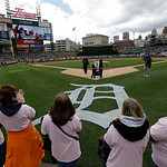 The Detroit Tigers honor mothers in attendance before the game against the Cleveland Indians before the first inning of a baseball game in Detroit, Sunday, May 12, 2013. (AP Photo/Carlos Oso …