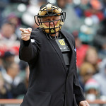 Home plate umpire Bill Miller signals during the seventh inning of a baseball game in Detroit, Sunday, May 12, 2013. (AP Photo/Carlos Osorio)