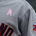 A breast cancer awarness logo is seen on Cleveland Indians'  Michael Brantley during the eighth inning of a baseball game against the Detroit Tigers in Detroit, Sunday, May 12, 2013. (AP Pho …