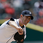 Detroit Tigers starting pitcher Rick Porcello throws during the first inning of an American League MLB baseball game against the Cleveland Indians in Detroit, Sunday, May 12, 2013. (AP Photo …