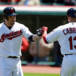 Cleveland Indians' Jason Kipnis, left, is congratulated by Asdrubal Cabrera after Kipnis hit a solo home run off New York Yankees relief pitcher David Phelps in the first inning in the first …