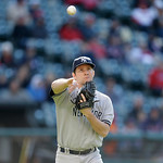 New York Yankees relief pitcher Adam Warren throws to first base in the eighth inning in the second baseball game of a doubleheader against the Cleveland Indians, Monday, May 13, 2013, in Cl …