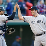 New York Yankees relief pitcher Adam Warren, right, is congratulated by catcher Austin Romine after New York defeated the Cleveland Indians 7-0 in the second baseball game of a doubleheader, …