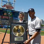 New York Yankees relief pitcher Mariano Rivera holds up a Rock Hall plaque given to him by the Cleveland Indians between the first and second baseball games of a doubleheader, Monday, May 13 …