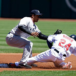 New York Yankees' Alberto Gonzalez, left, tags out Cleveland Indians' Michael Bourn after Bourn tried to steal to second base in the first inning in the first baseball game of a doubleheader …