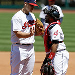 Cleveland Indians starting pitcher Justin Masterson, left, talks with catcher Carlos Santana in the fifth inning in the first baseball game of a doubleheader against the New York Yankees, Mo …