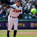 Cleveland Indians pitcher Trevor Bauer throws to first base to try and get New York Yankees' Jayson Nix out in the first inning in the second baseball game of a doubleheader against the New  …